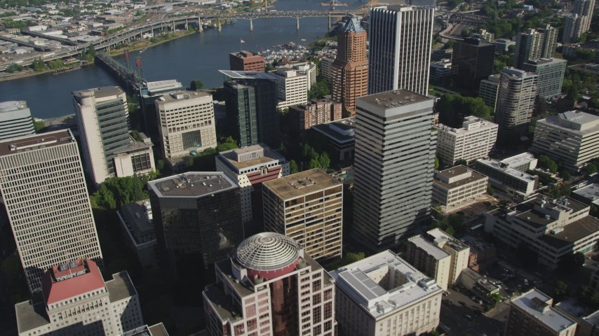 5K stock footage aerial video of flying over skyscrapers and track KOIN Center, Downtown Portland, Oregon Aerial Stock Footage | AX53_045