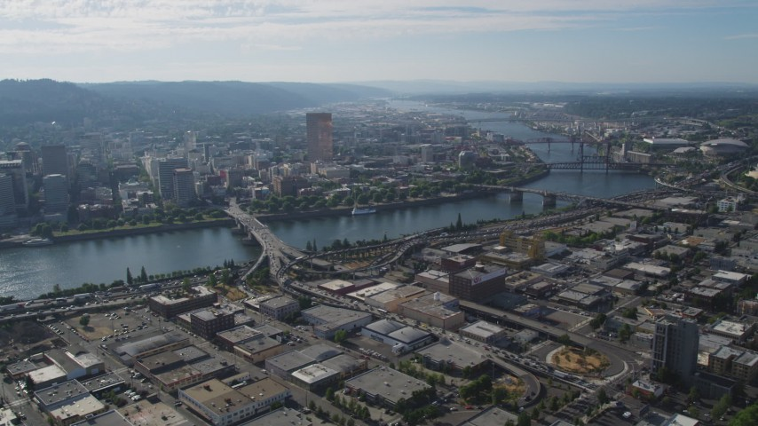 Downtown Portland cityscape seen from industrial area, Portland, Oregon Aerial Stock Footage | AX53_047