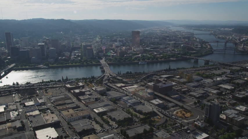 5K stock footage aerial video of Downtown Portland cityscape seen from industrial area, Portland, Oregon Aerial Stock Footage | AX53_047