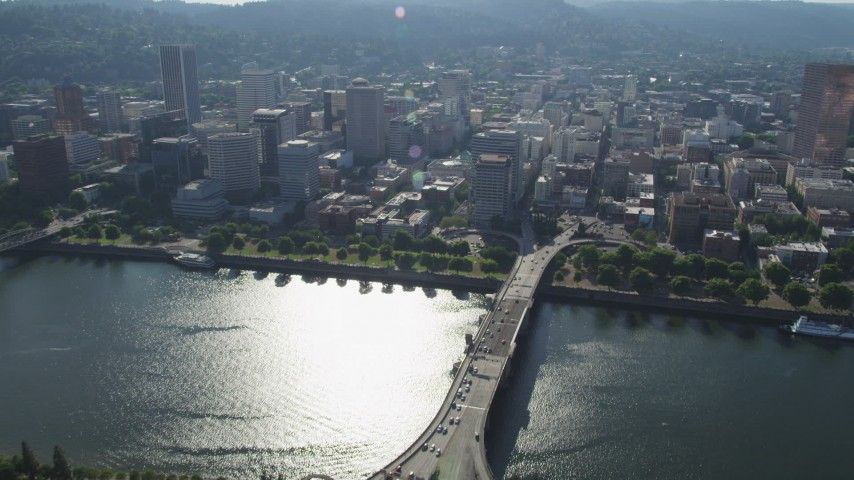 5K stock footage aerial video fly over Morrison Bridge and Willamette River toward Downtown Portland, Oregon Aerial Stock Footage | AX53_048
