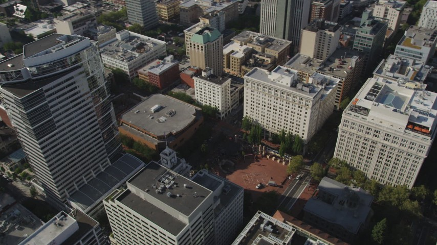 5K stock footage aerial video fly over downtown and tilt to Pioneer Courthouse Square, Downtown Portland, Oregon Aerial Stock Footage | AX53_049