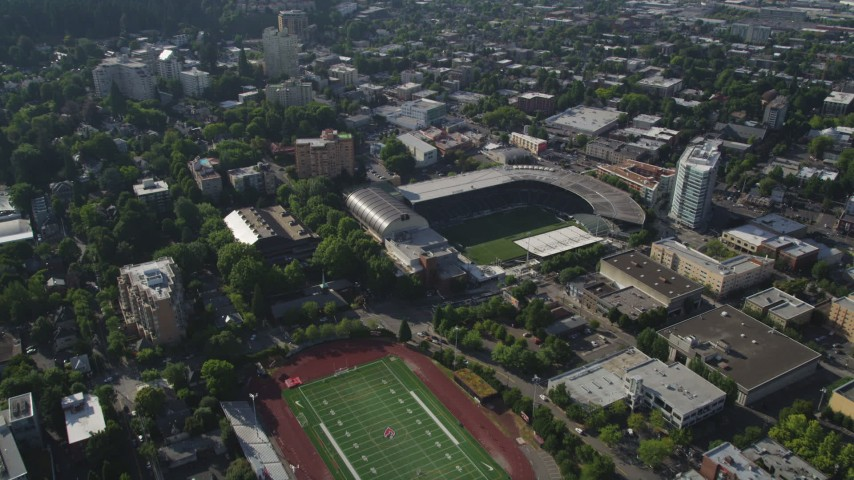 5K stock footage aerial video fly by high school football field and Major League soccer field, Providence Park, Downtown Portland, Oregon Aerial Stock Footage | AX53_050