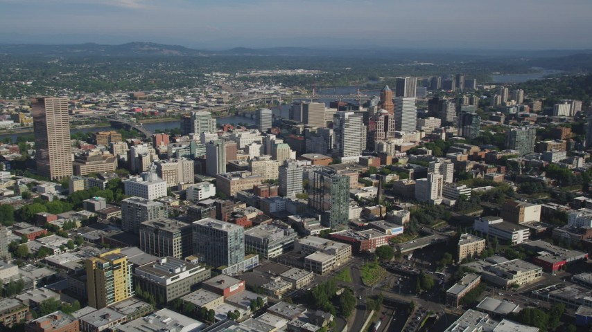 5K stock footage aerial video of approaching city skyscrapers and high-rises, Downtown Portland, Oregon Aerial Stock Footage | AX53_052