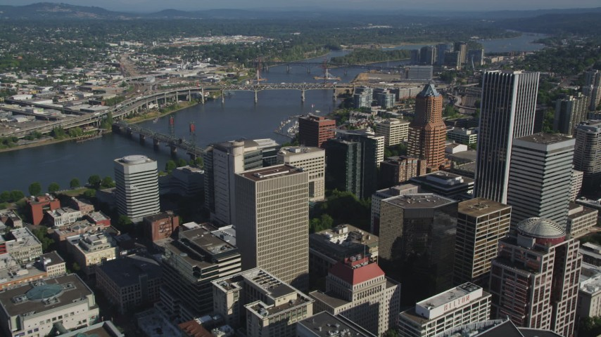 5K stock footage aerial video fly over city buildings toward skyscrapers, Downtown Portland, Oregon Aerial Stock Footage | AX53_053
