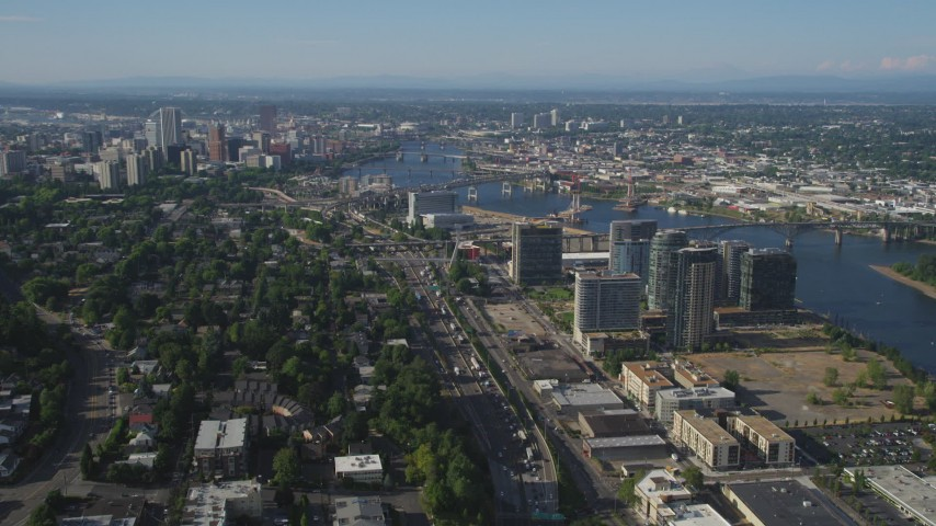 5K stock footage aerial video wide view of city sprawl, skyscrapers, and river, South Waterfront and Downtown Portland, Oregon Aerial Stock Footage | AX53_059