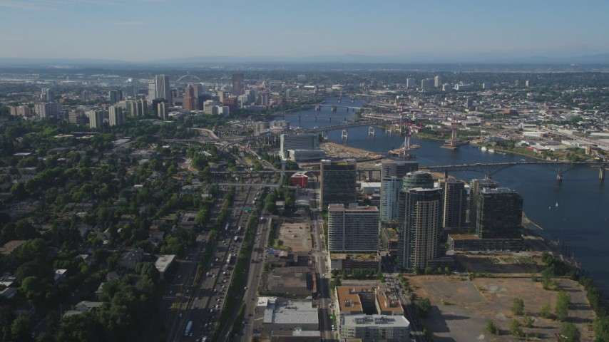 5K stock footage aerial video of city sprawl, skyscrapers, high-rises and river, Downtown Portland, Oregon Aerial Stock Footage AX53_060 | Axiom Images