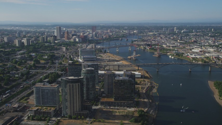 Downtown Portland skyscrapers and high-rises seen from Ross Island Bridge and South Waterfront, Portland, Oregon Aerial Stock Footage | AX53_061