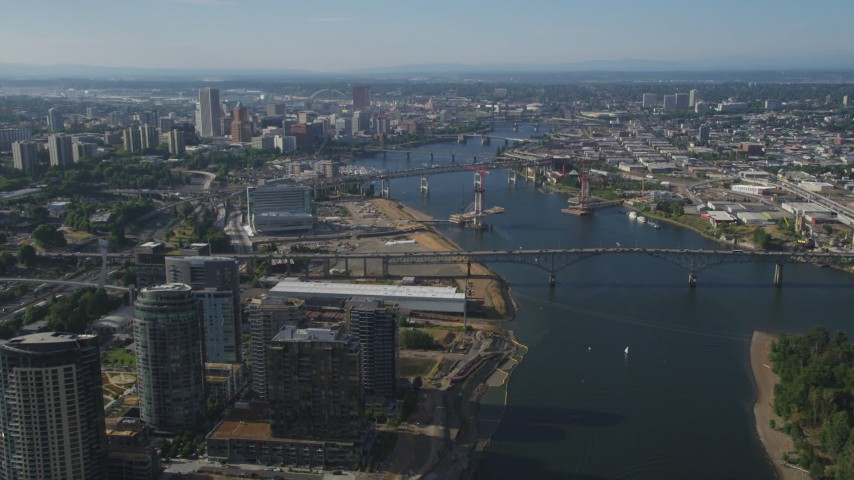 5K stock footage aerial video of Downtown Portland skyscrapers and high-rises seen from Ross Island Bridge and South Waterfront, Portland, Oregon Aerial Stock Footage | AX53_061