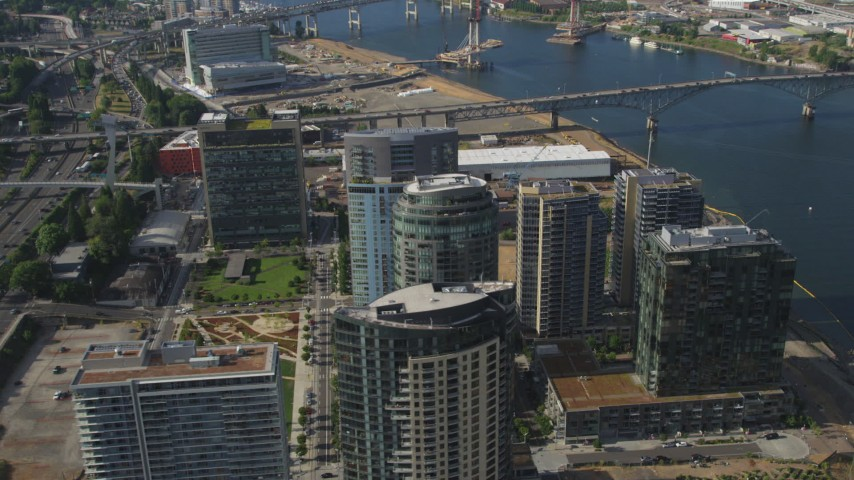 5K stock footage aerial video fly away from John Ross Tower, The Ardea and South Waterfront skyscrapers, Portland, Oregon Aerial Stock Footage | AX53_063