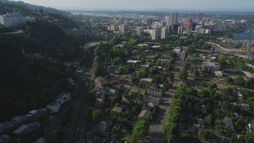 5K stock footage aerial video of tracking a gondola over homes and city streets, Southwest Portland, Oregon Aerial Stock Footage | AX53_064