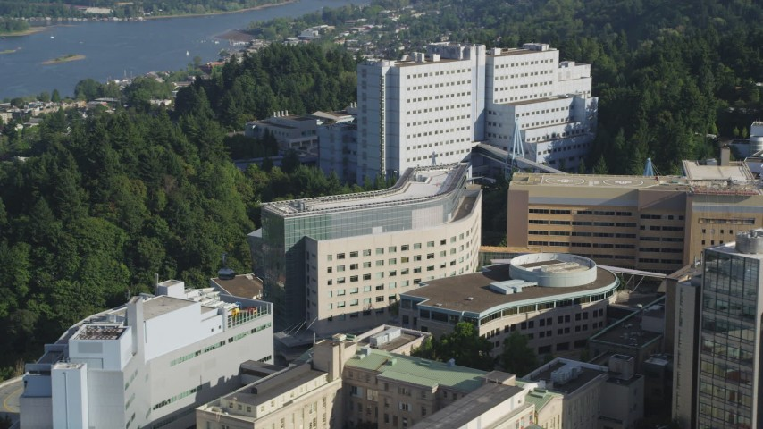 5K stock footage aerial video of tracking a gondola through Oregon Health and Science University, Portland Aerial Stock Footage | AX53_067