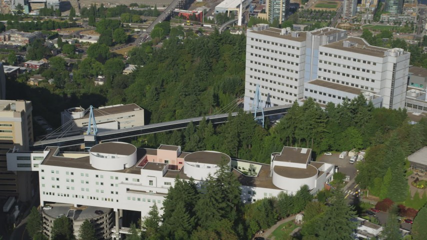 5K aerial video of flying by Oregon Health and Science University, Portland, Oregon Aerial Stock Footage | AX53_069