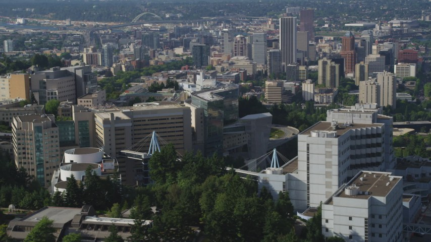 5K stock footage aerial video fly by Oregon Health and Science University revealing Downtown Portland, Oregon Aerial Stock Footage | AX53_070