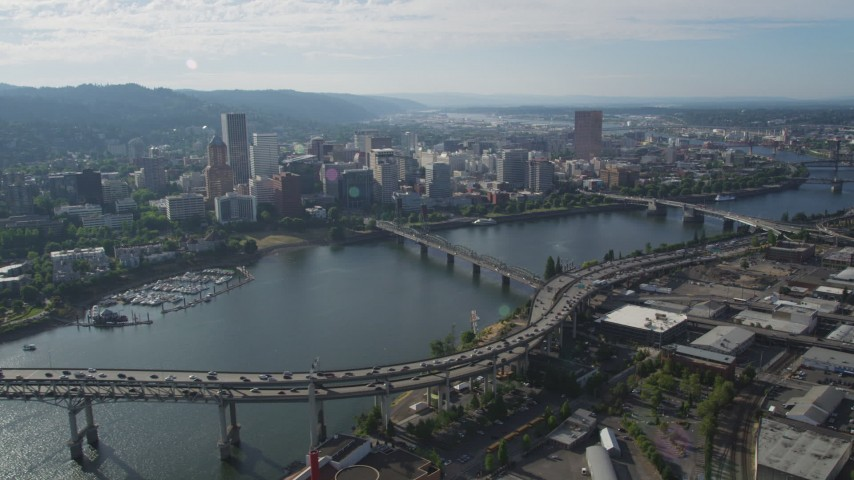 Fly along Willamette River and Downtown Portland buildings, Portland, Oregon Aerial Stock Footage | AX53_073