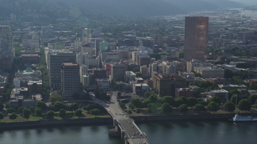 5K stock footage aerial video of skyscraper and high-rises from the Willamette River, Downtown Portland, Oregon Aerial Stock Footage | AX53_075