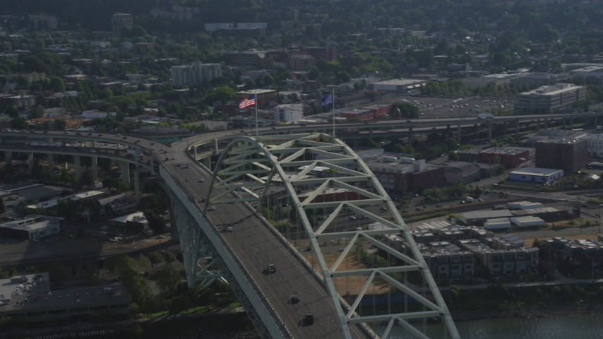 5K stock footage aerial video of orbiting Fremont Bridge and tilt up on the American Flag, Portland, Oregon Aerial Stock Footage | AX53_078