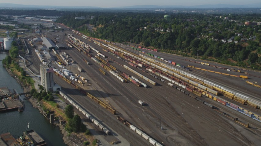5K stock footage aerial video of flying by trains at a train yard, North Portland, Oregon Aerial Stock Footage | AX53_080