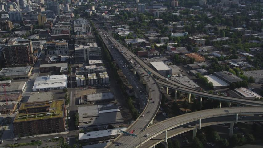 5K stock footage aerial video fly by heavy traffic on interstate 405 and Highway 30, Downtown Portland, Oregon Aerial Stock Footage | AX53_083