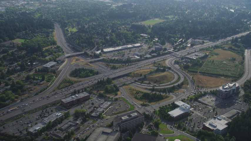 5K stock footage aerial video fly by freeway interchange with traffic backing up beside strip mall, Southwest Portland, Oregon Aerial Stock Footage | AX53_093
