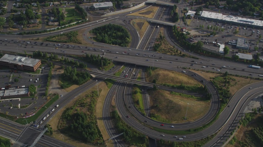 5K stock footage aerial video of traffic backing up by a freeway interchange, Southwest Portland, Oregon Aerial Stock Footage | AX53_094