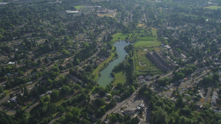 5K stock footage aerial video flyby a lake in a suburban neighborhood, Beaverton, Oregon Aerial Stock Footage | AX53_096