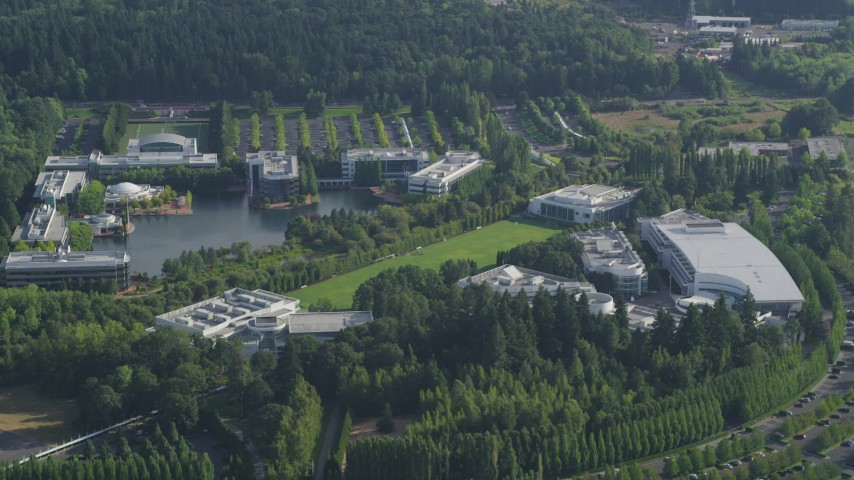 5K stock footage aerial video fly by Nike Headquarters nestled among trees, Beaverton, Oregon Aerial Stock Footage | AX53_098