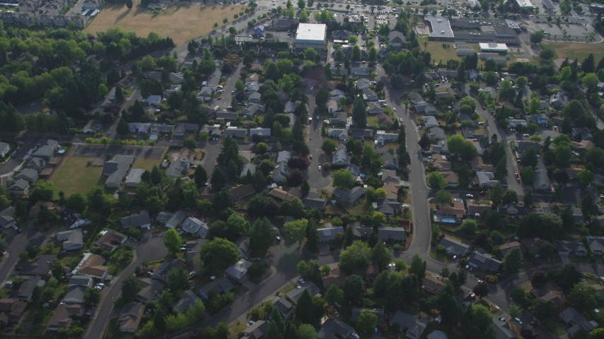 5K aerial video tilt to bird's eye of tract homes and tiny condo units, Beaverton, Oregon Aerial Stock Footage | AX53_100