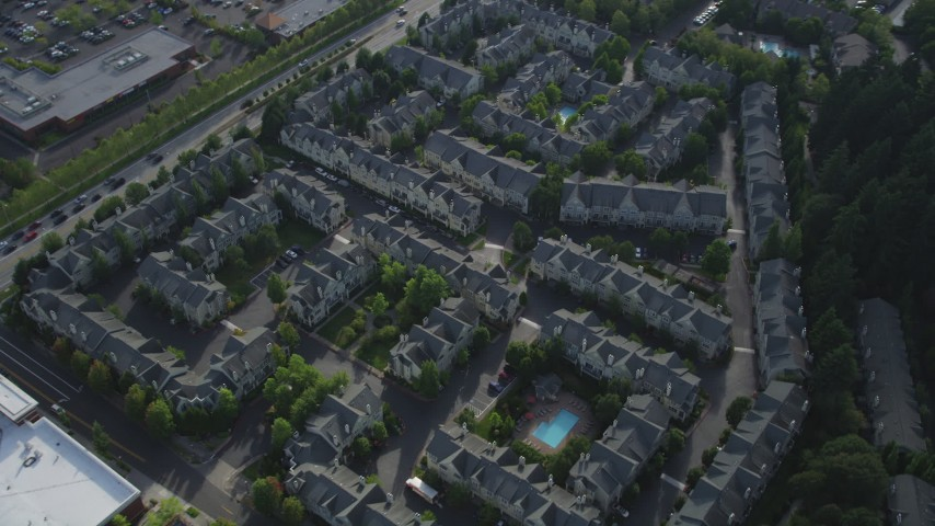 5K stock footage aerial video approach and tilt to bird's eye of apartment buildings, Hillsboro, Oregon Aerial Stock Footage | AX53_102