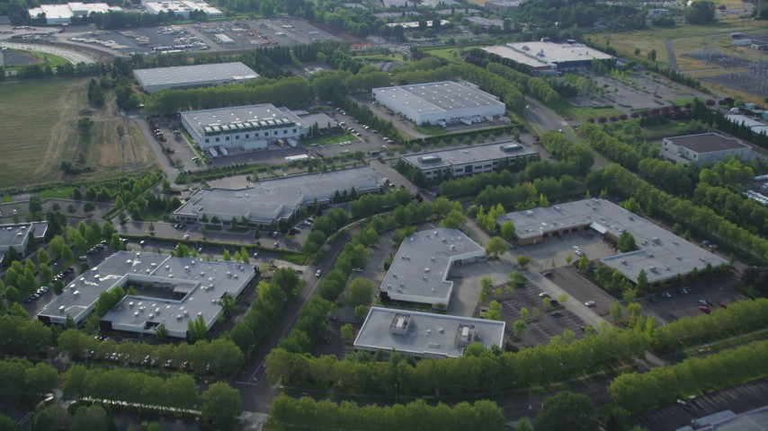 5K stock footage aerial video of flying over one-story office buildings and warehouses, Hillsboro, Oregon Aerial Stock Footage | AX53_103