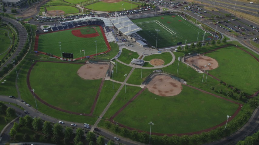 5K stock footage aerial video of passing a sports and recreation complex, Hillsboro, Oregon Aerial Stock Footage | AX53_105