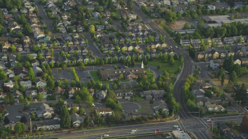 5K stock footage aerial video of passing the Church of Jesus Christ of Latter Day Saints, Beaverton, Oregon, sunset Aerial Stock Footage | AX54_002
