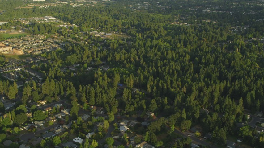5K aerial video approach and tilt to homes, Beaverton, Oregon, sunset Aerial Stock Footage | AX54_003