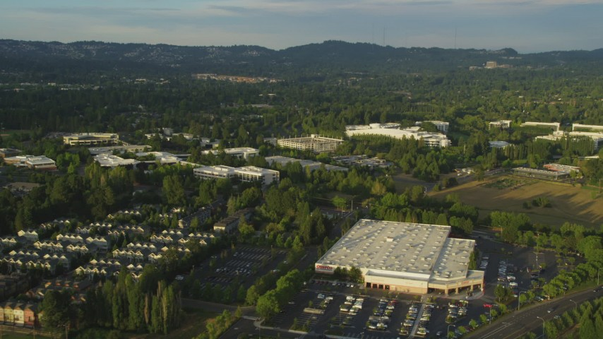 5K stock footage aerial video of flying by Costco, approaching Nike Headquarters, Beaverton, Oregon, sunset Aerial Stock Footage | AX54_004