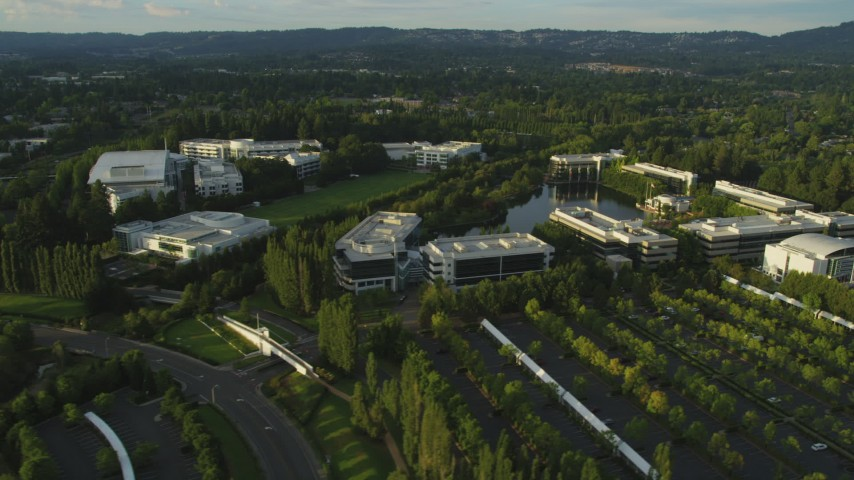 5K stock footage aerial video of flying by Nike Headquarters in Beaverton, Oregon, sunset Aerial Stock Footage | AX54_005
