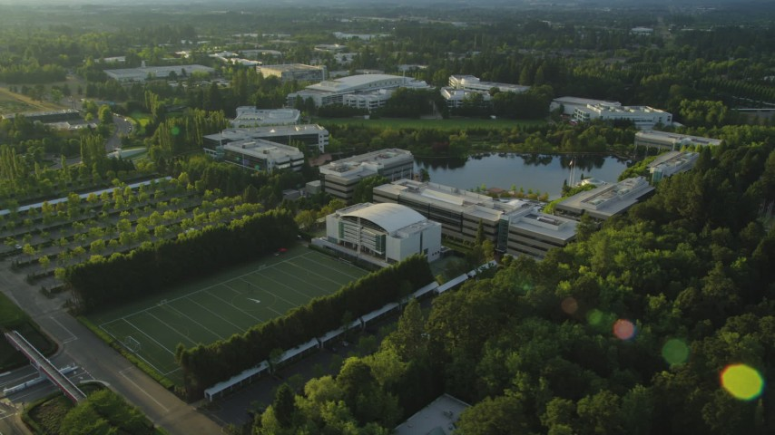 5K stock footage aerial video of flying by Nike Headquarters, Beaverton, Oregon, sunset Aerial Stock Footage | AX54_006