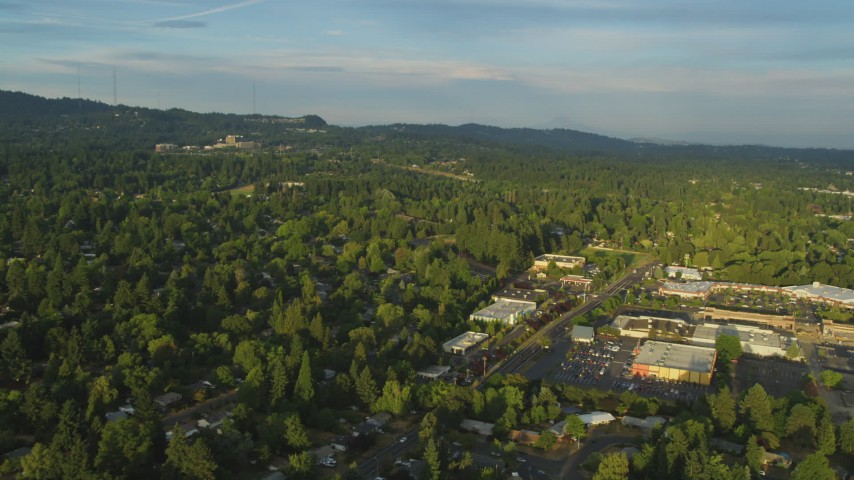 5K stock footage aerial video approach and fly over suburban homes and a shopping center, Beaverton, Oregon, sunset Aerial Stock Footage | AX54_007