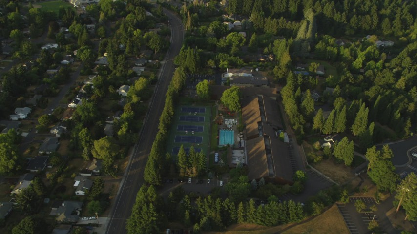 5K stock footage aerial video of flying over a community sports center in Beaverton, Oregon, sunset Aerial Stock Footage | AX54_008
