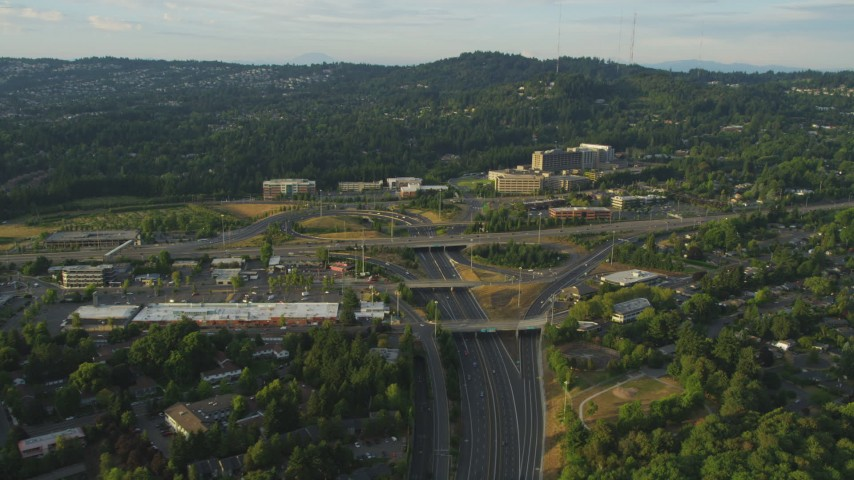 5K stock footage aerial video fly by Providence St. Vincent Medical Center, highway, Portland, Oregon, sunset Aerial Stock Footage | AX54_010