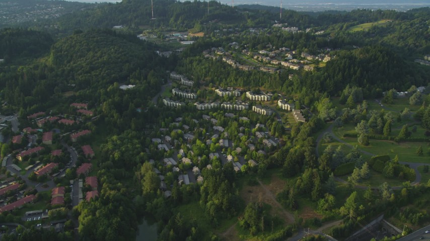 5K stock footage aerial video of flying by hillside apartment building, Southwest Portland, Oregon, sunset Aerial Stock Footage | AX54_013