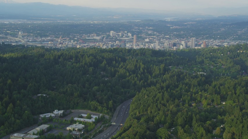 5K stock footage aerial video of flying over Highway 26, tilt up to Downtown Portland, Oregon, sunset Aerial Stock Footage | AX54_014