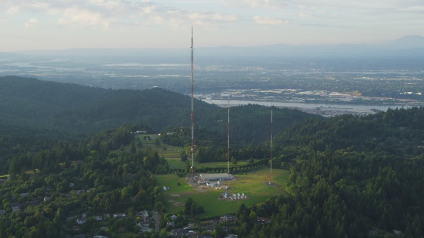 5K stock footage aerial video of flying by hilltop radio towers in Southwest Portland, Oregon, sunset Aerial Stock Footage | AX54_015