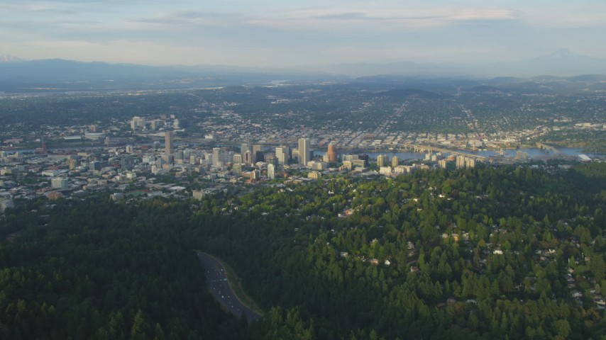 5K aerial video of approaching Downtown Portland, seen from Southwest Portland, Oregon, sunset Aerial Stock Footage | AX54_016