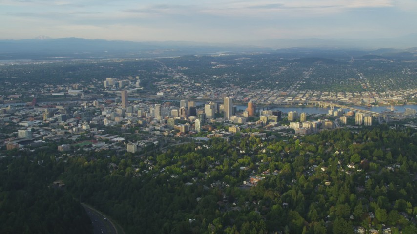 5K stock footage aerial video of approaching Downtown Portland, from Southwest Portland, Oregon, sunset Aerial Stock Footage | AX54_017