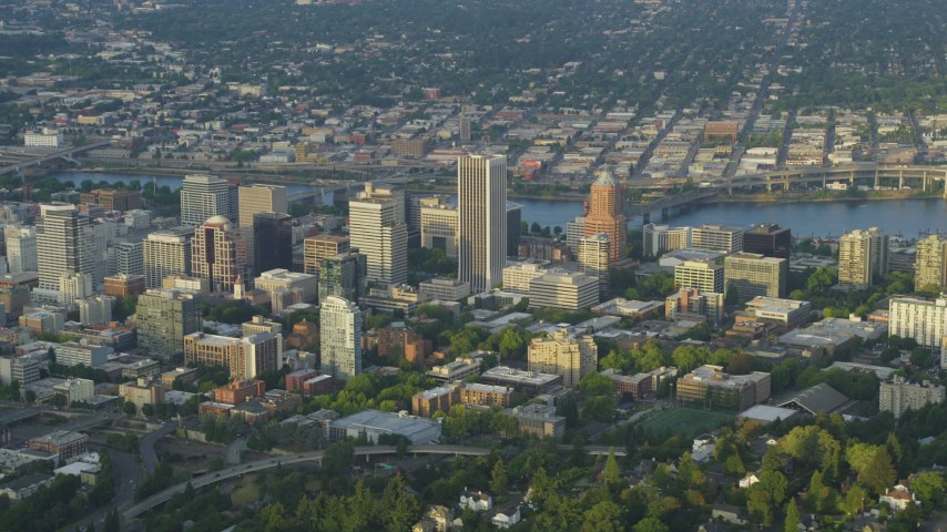 5K stock footage aerial video of flying by downtown buildings, Downtown Portland, Oregon, sunset Aerial Stock Footage | AX54_018