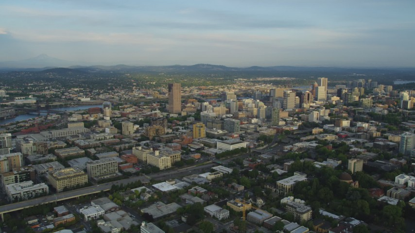 5K stock footage aerial video of flying by downtown buildings, I-405, Downtown Portland, Oregon, sunset Aerial Stock Footage | AX54_020