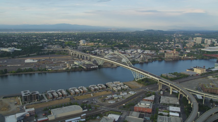 5K stock footage aerial video of flying by the Fremont Bridge, spanning Willamette River, Downtown Portland, Oregon, sunset Aerial Stock Footage | AX54_021