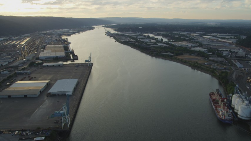 5K stock footage aerial video of riverfront warehouses by the Willamette River, Northwest Industrial, Portland, Oregon, sunset Aerial Stock Footage | AX54_023