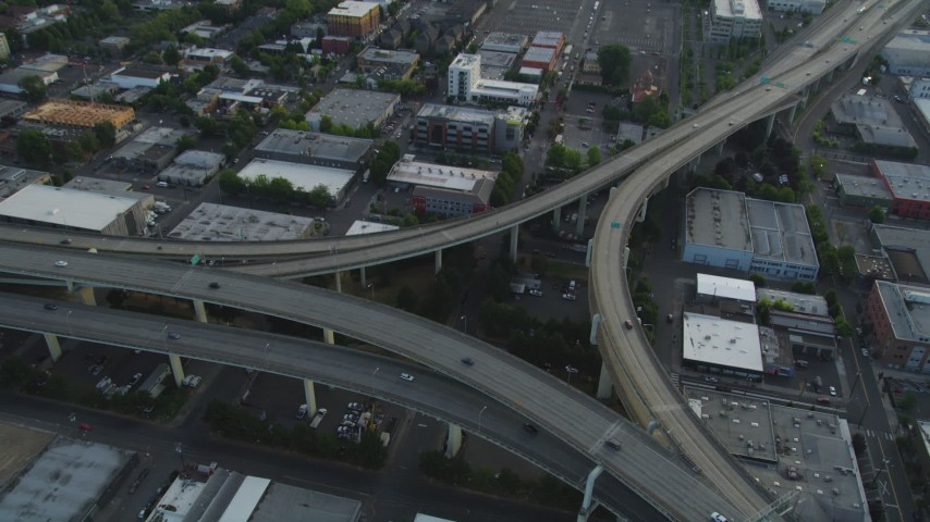 5K stock footage aerial video tilt to bird's eye of Highway 30 and Interstate 405 interchange, Portland, Oregon, sunset Aerial Stock Footage | AX54_025