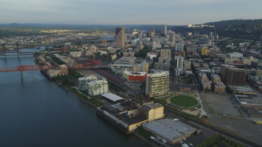5K stock footage aerial video fly over Willamette River, Fremont Bridge, pan to Downtown Portland, Oregon, sunset Aerial Stock Footage | AX54_028