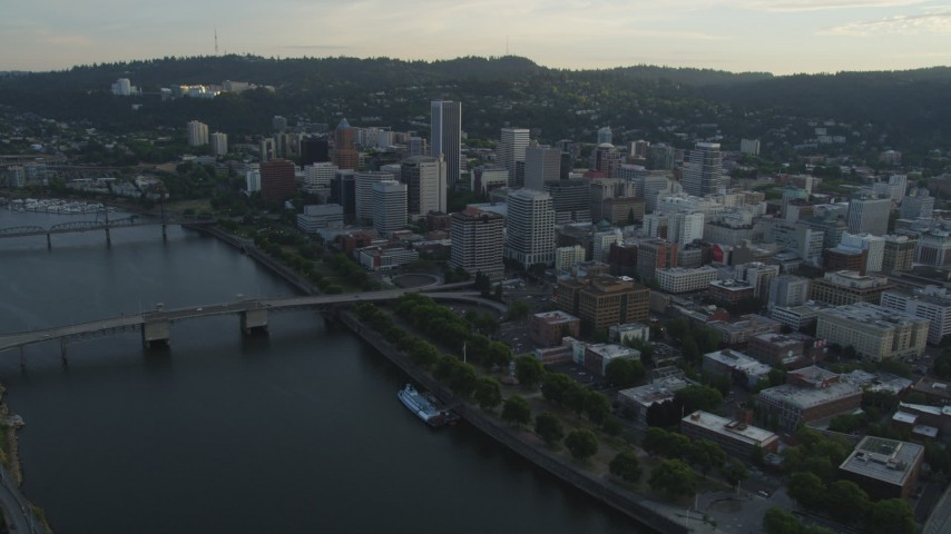 5K stock footage aerial video of flying by downtown, Morrison Bridge, Downtown Portland, Oregon, sunset Aerial Stock Footage | AX54_031